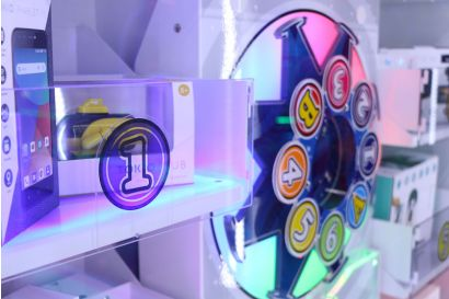 Prize Arrow - A Closeup of the colourfully lit target wheel and prize stand