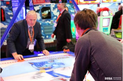 Sonic Sports Air Hockey - 2 Player concentrating to scoring a point