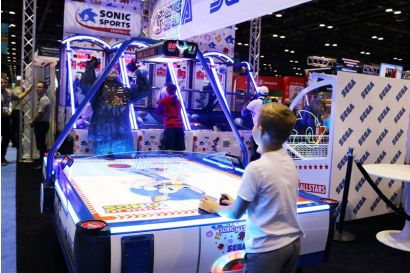 Sonic Sports Air Hockey - A child playing air hockey with a werewolf mascot
