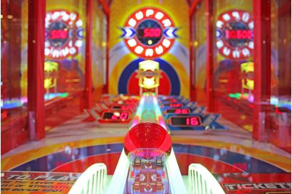 Power Roll - A closeup view of the playfield and beautifully lit cabinet