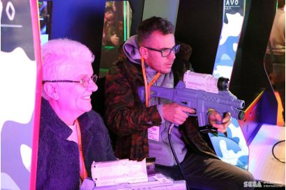 Target Bravo: Operation Ghost DLX - Grandma smiling and having fun playing Target Bravo: OG with her grandson