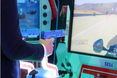 Mission: Impossible Arcade - A closeup of a player's hands on the controller