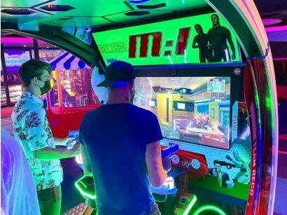 Mission: Impossible Arcade - Two players concentrating on the game